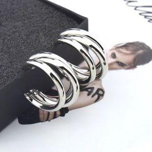 Tri silver small hoop earrings